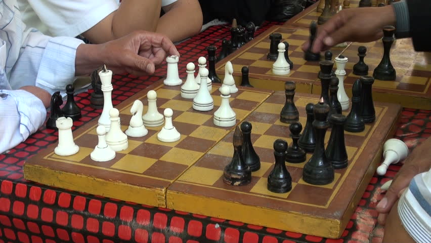 OSH, KYRGYZSTAN - 30 JUNE 2013: Playing a game of chess in a park in Osh
