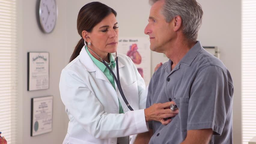 Woman doctor listening to elderly patient's heartbeat | Shutterstock HD Video #4781939