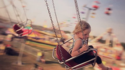 Riding Swings at Fair