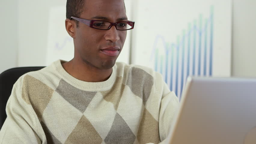 Black business man working at laptop computer   Shutterstock HD Video #4782539