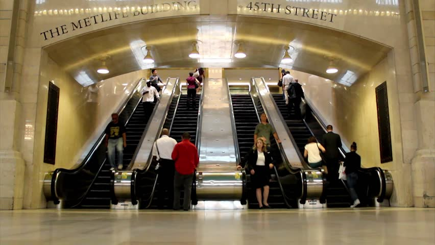 NEW YORK, SEPTEMBER 03: Passengers in the grand central station in September 03, 2013 in New York. It is the busiest and largest train station in the world by number of platforms: 44, with 67 tracks