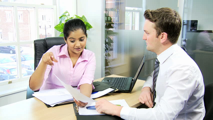Male Human Resources Representative Interviewing Young South Asian – Human Resources Representative