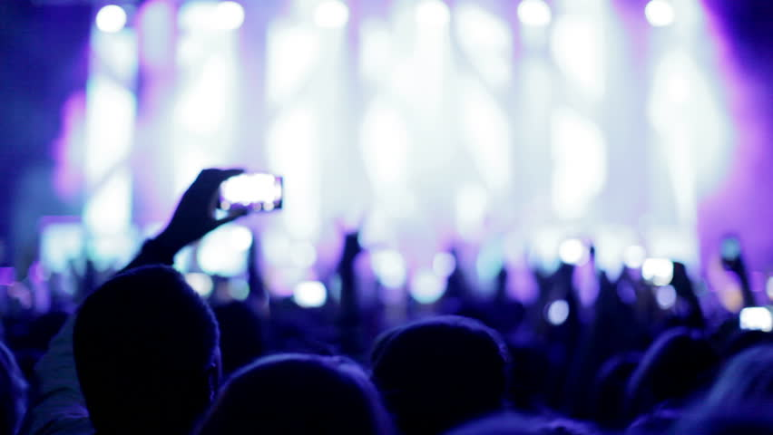 Crowd making party at a rock concert. Hands hold cameras with digital displays among people at rock concert #4826759