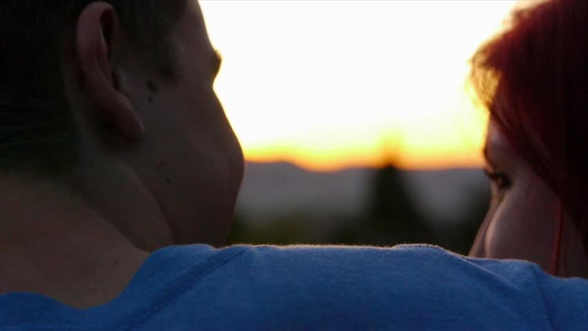 Close Up Of Couple Enjoying The Sunset
