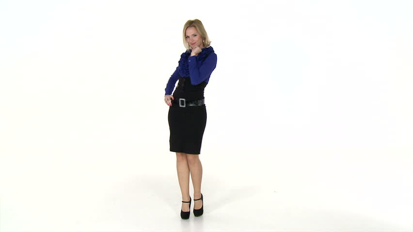 Wide shot of a businesswoman flirting with camera. High definition video on white studio background.