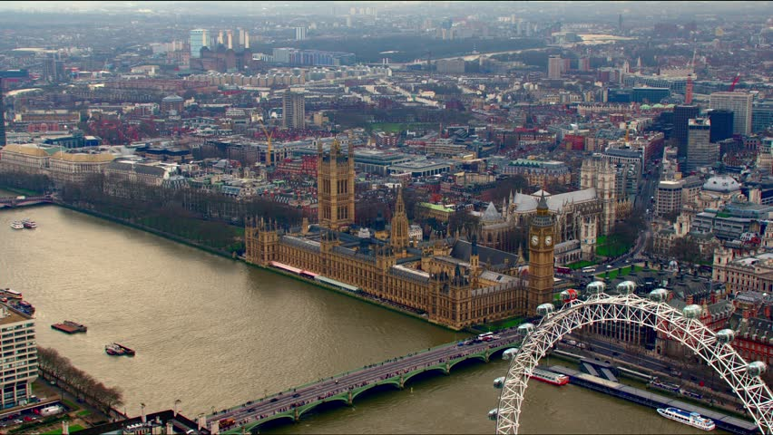 Stunning panoramic aerial shot along the River Thames in Central London. Features the Houses of Parliament & The London Eye.
