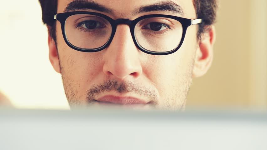 Man using digital tablet touchscreen computer ipad