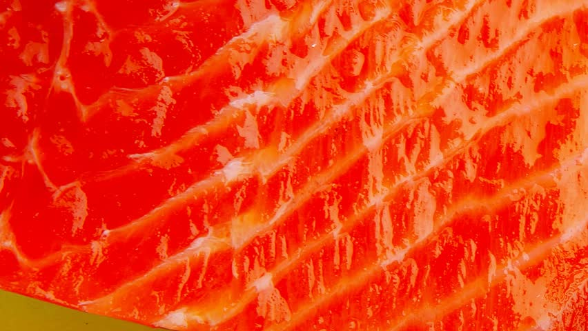 smoked salmon bar on plate with vegetables 1920x1080 intro motion slow hidef hd #4861559