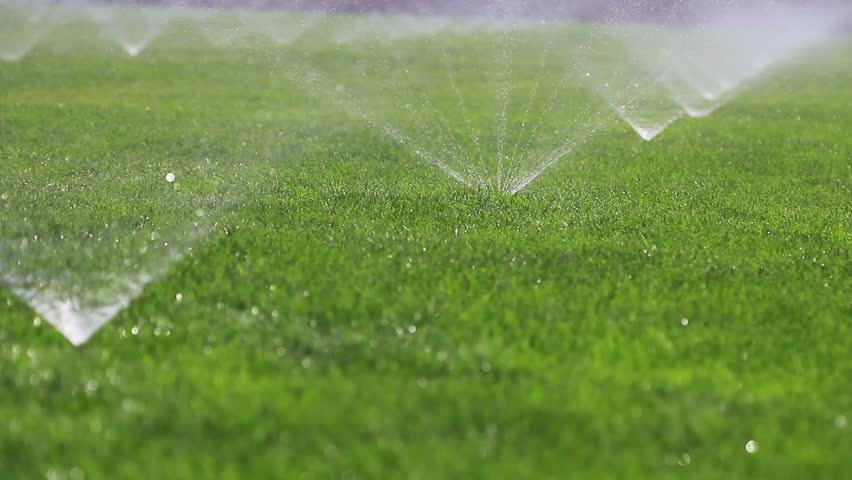 Irrigating grass with water sprinkler,in temple of heaven,beijing