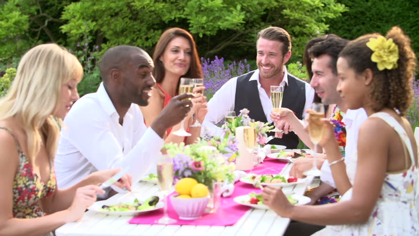 slow motion sequence of young adults enjoying fancy outdoor dinner