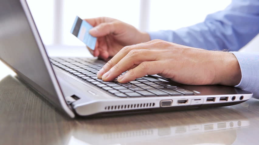 """"""" Making online bank transfers / HD stock footage of man's hand holds a credit card while entering data in laptop"""
