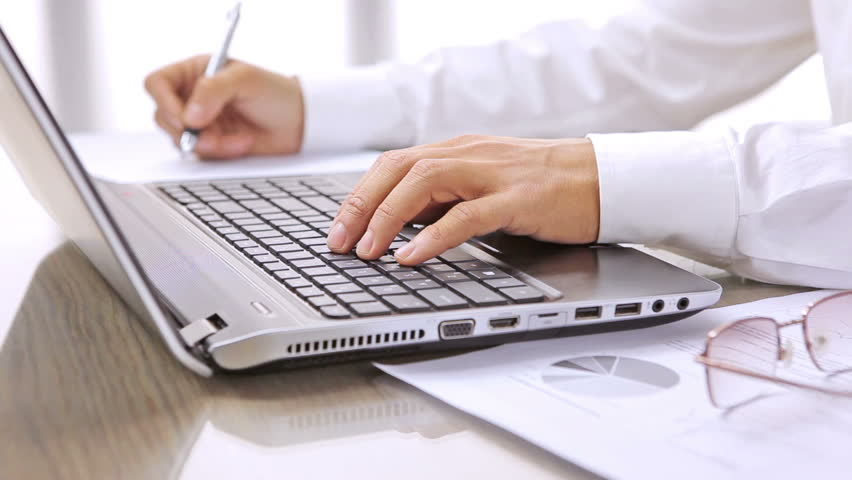 Image result for person writing at computer