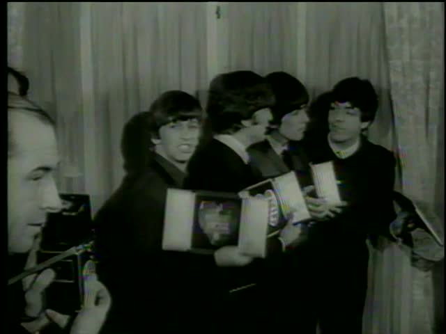 George Harrison, Paul McCartney,  Ringo Starr and John Lennon pose the Variety Club silver hearts awards, London circa 1964-MGM PICTURES, UNIVERSAL-INTERNATIONAL NEWSREEL, USA, filmed in 1964