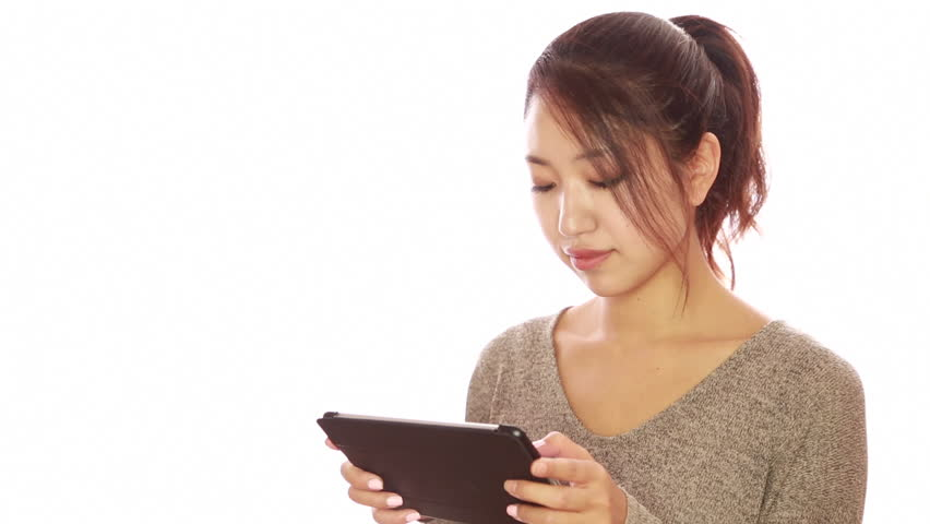 Pretty young woman with headphones on head plays with tablet on asian young woman girl white background studio using tablet pc computer reading ebook hd stock fandeluxe Ebook collections