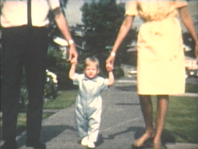 1960s home video of mom and dad teaching toddler son to walk, Seattle, Washington.