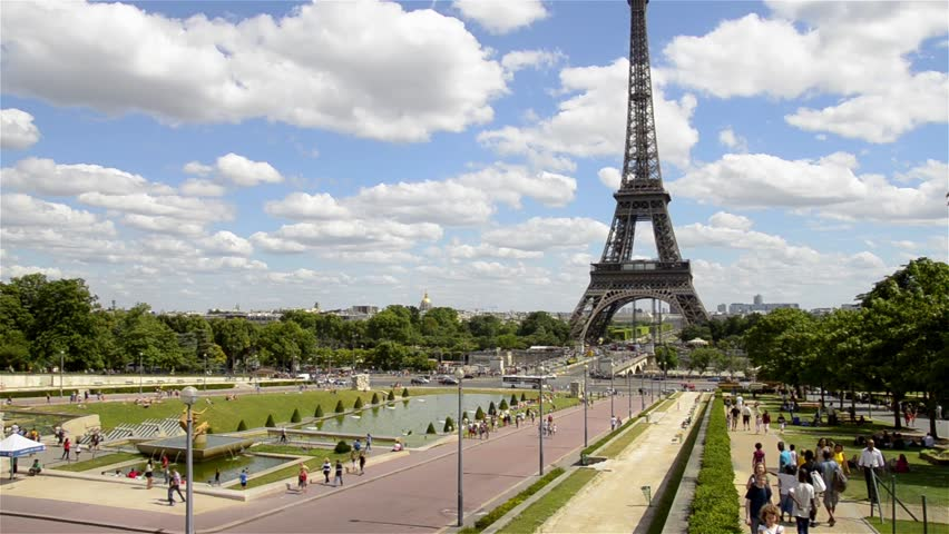 Scene of the Eiffel tower in Paris. August 19 -  2013. Paris is one of the most popular travel locations in Europe. The Eiffel towel attracts more than 7 million visitors every year.