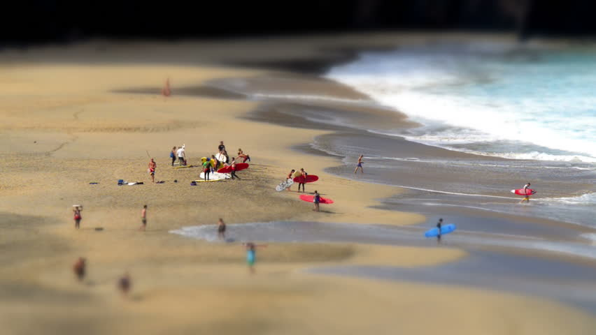 A tilt shift time lapse with surfers leaving a nudist beach. No recognizable people, nudity, trademarks or logos! 11132