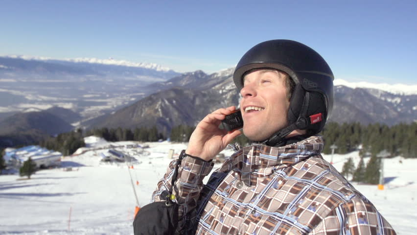 Slow Motion Of Skier Taking A Break And Making Telephone Call On The Snowy