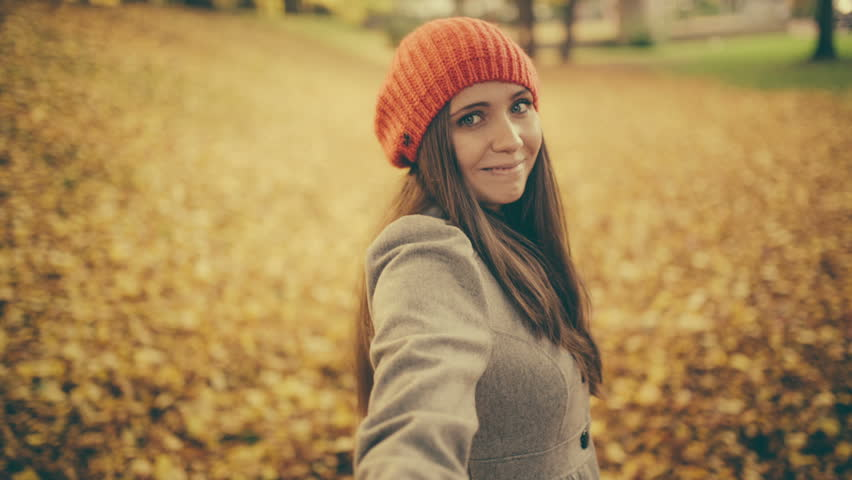 Young woman pulling her boyfriend through autumn park with leafs pov #4972241