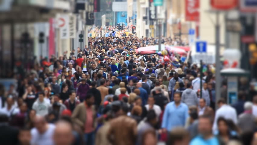 Slow motion city pedestrian traffic shot on a busy Brussels shopping street using a tilt shift effect.