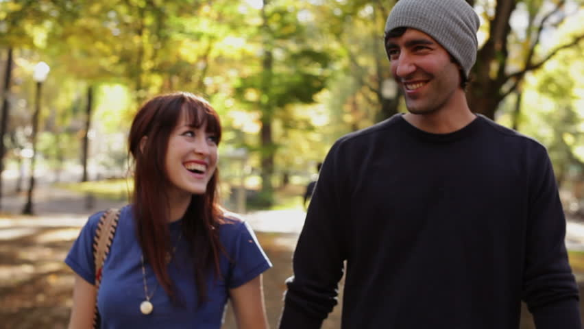 Romantic couple running and walking in park | Shutterstock HD Video #4979336