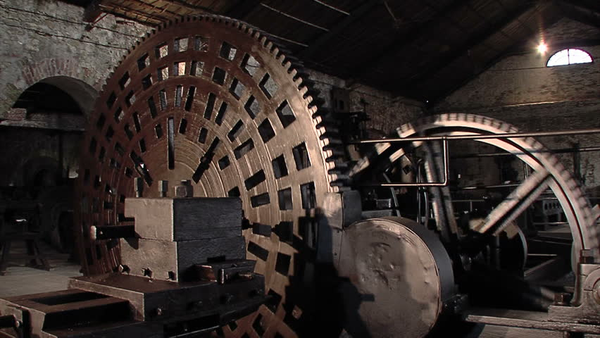 Old machine with big cogwheel