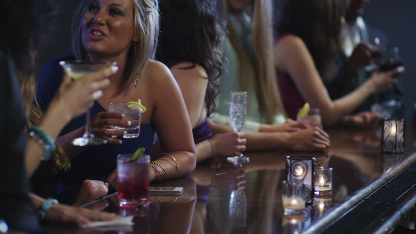 Close up of people hands at a bar drinking drinks   Shutterstock HD Video #4991519
