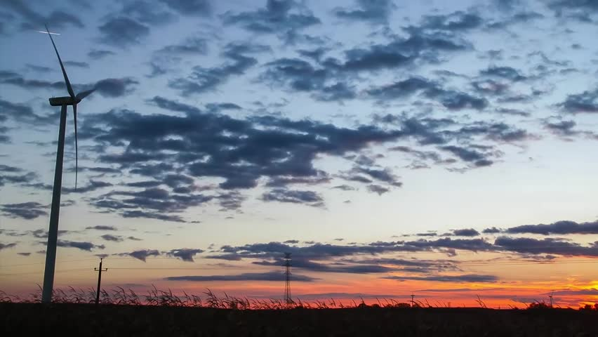 Clean Energy - Wind turbines at sunset, time lapse video