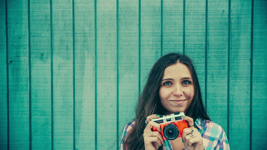 Woman with vintage Camera in front copy space