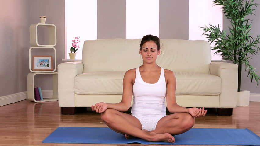 Fit Attractive Brunette Doing Yoga Exercise In Living Room At Home