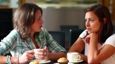 Two students chatting together in the canteen at the university