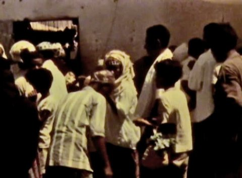 ADEN PROTECTORATE, CIRCA 1960: Public market vintage film. British Aden Protectorate in southern Arabia.  One of a kind private owned vintage and historic 8mm film. Republic of Yemen.
