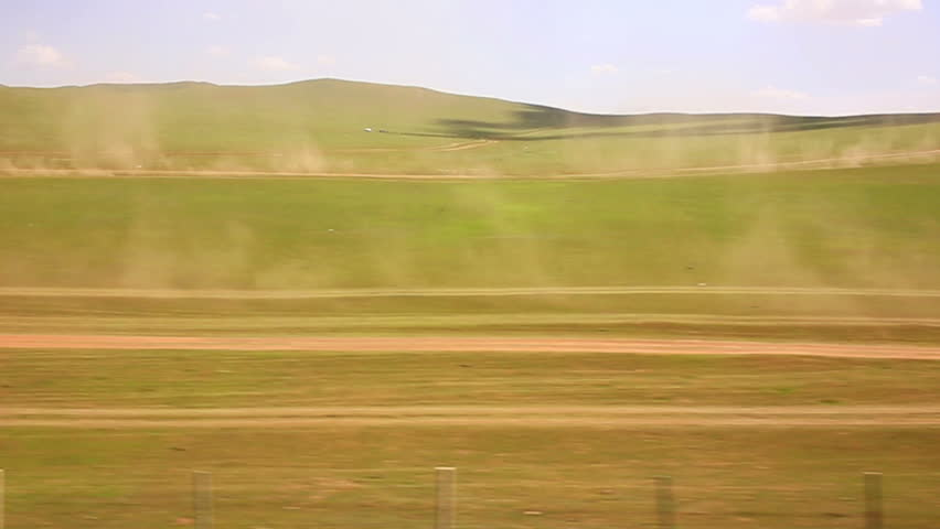 cars going vast grassland of mongolia, view from trans siberian train window