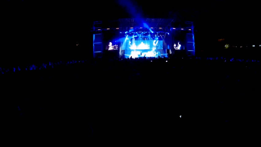 Crowd at a rock concert, back light silhouette  | Shutterstock HD Video #5073569