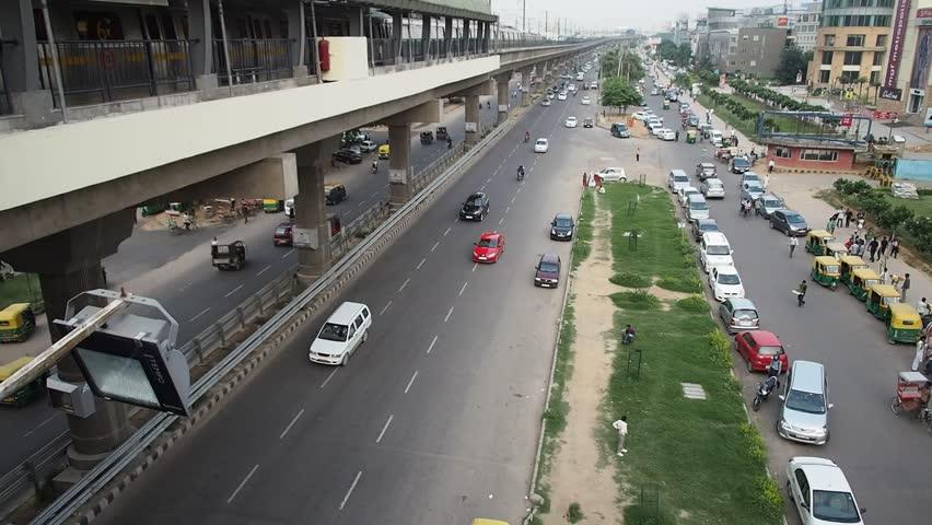 Elevated train and road traffic, New Delhi, India
