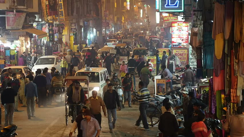New Delhi, India - January 16: People and traffic on busy street in the neighborhood of Paharganj in New Delhi, India.