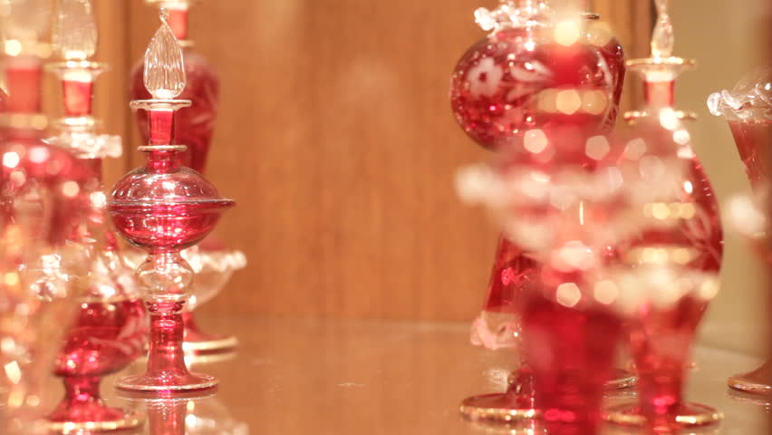 close up of red crystal glass in cabinet going in and out of focus