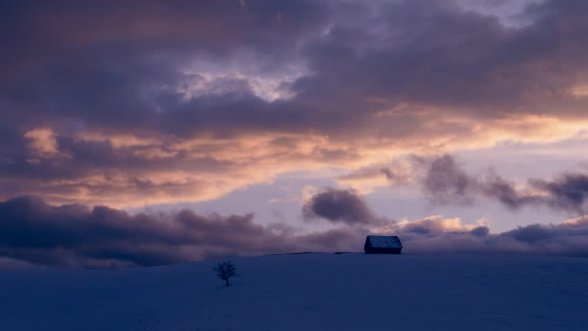 Dramatic clouds at sunset in winter landscape
