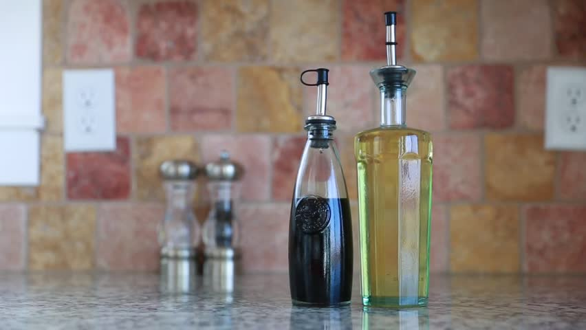 Glass containers with olive oil and balsamic vinegar