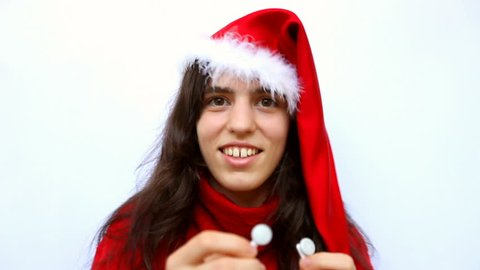 6e760fac7 attractive young adult woman playing santa claus wearing red hat portrait.  christmas and new year