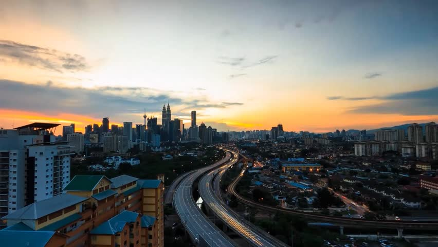 Timelapse of Kuala Lumpur with sunset view and busy traffic on the highway with zoomed out. | Shutterstock HD Video #5163689