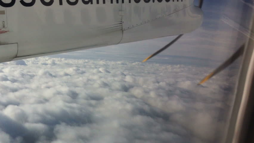 Above the clouds. Airplane engine in flight