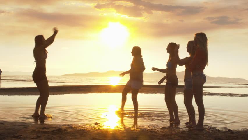 Group of Five Teenage Girls Having Fun The Beach At Sunset #5222639