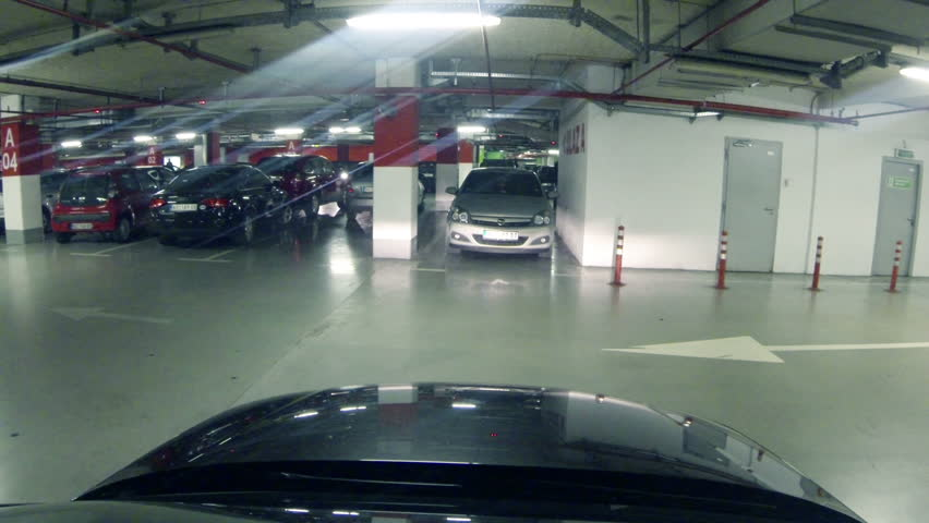 Car Leaving Parking Lot Near Shopping Centre Stock Footage Video