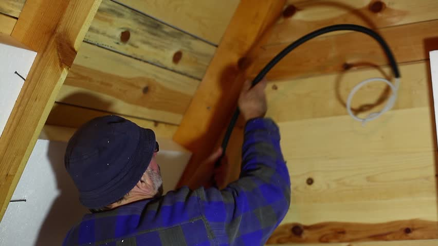 A Repairmen Placing An Electric Cable In A Weekend Cottage   HD Stock Video  Clip