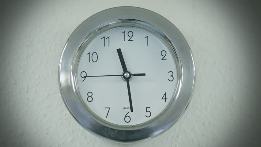 Wall clock. A wall clock ticking away, filmed on the Blackmagic Cinema Camera.