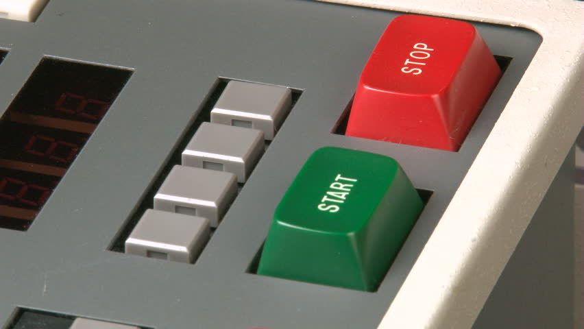 Finger pressing the start and stop button   Shutterstock HD Video #524710