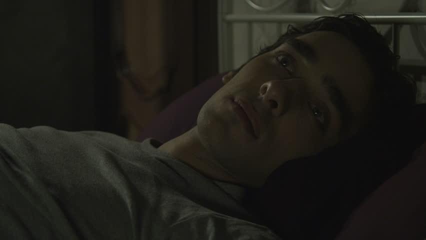 Young man wakes up at night