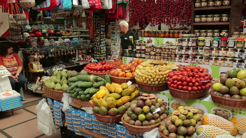 FUNCHAL, MADEIRA/PORTUGAL - NOVEMBER 14: Fruit stall at Funchal Workers Market on November 14, 2013 in Funchal. The market was built in 1940 to provide a central location to sell local produce.