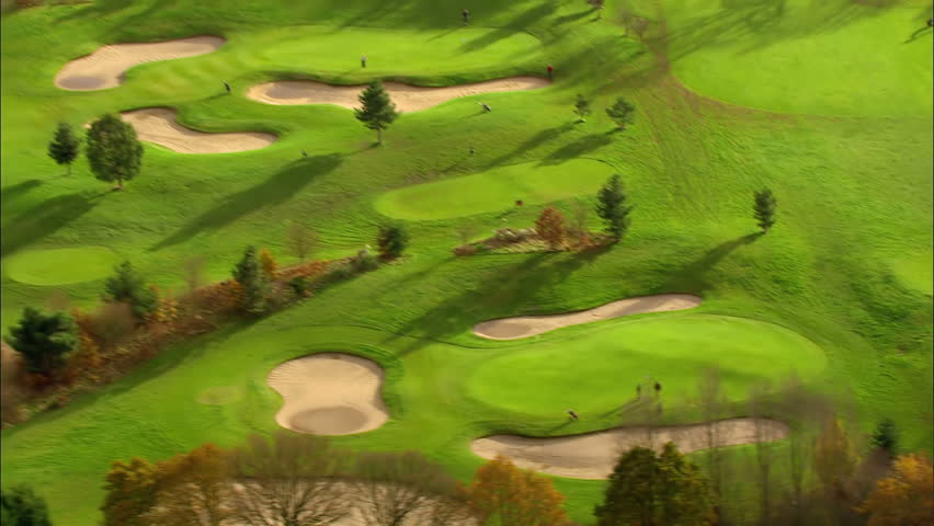 Aerial view over a golf course set in the English countryside